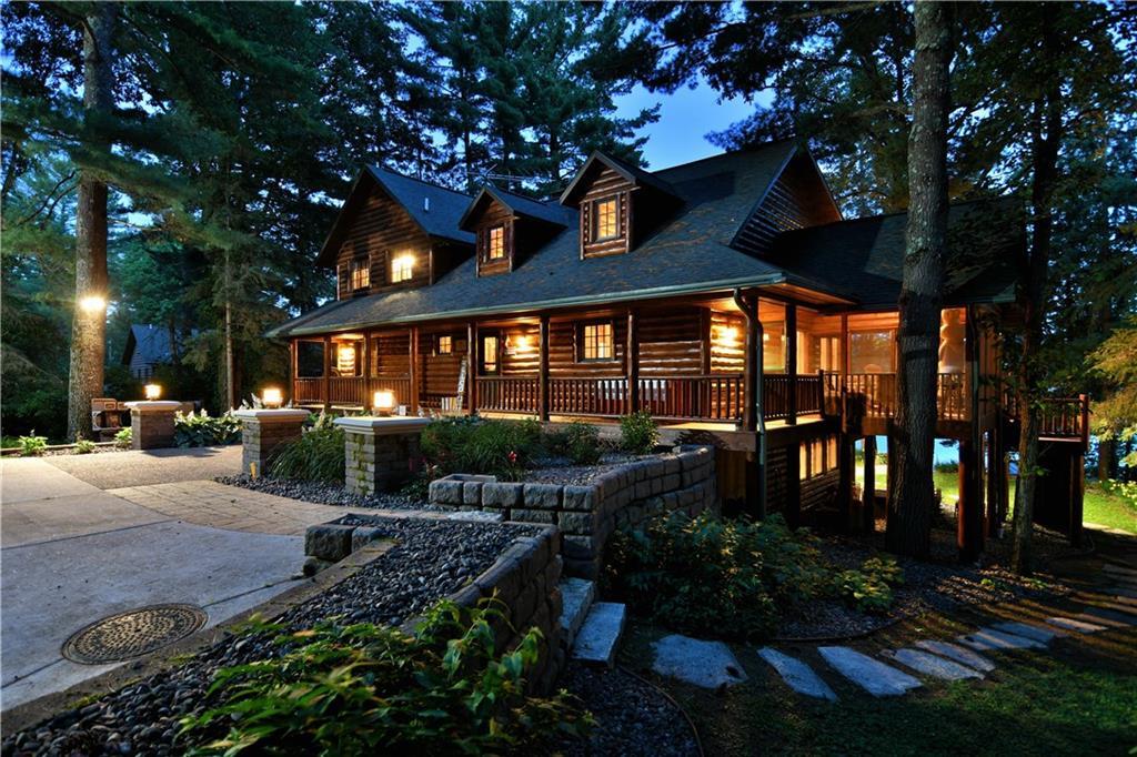 Beautiful Log Home at night with illuminated exterior